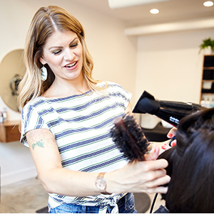 Jennifer Kelley styling hair
